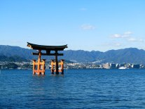 The Great Torii in the afternoon appears to float in Hiroshima Bay