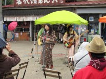A local band performing for the rain-soaked crowd