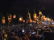The opening procession features lanterns painted with the names of the Chichibu neighborhoods the carrier represents.