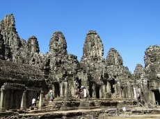 "Bayon temple stands at the exact center of the ancient capital of Angkor Thom. Around 200 faces of Lokesvara, the bodhisattva of compassion, are carved on Bayon's towers, giving it the nickname of ""The Temple of Smiling Gods."""