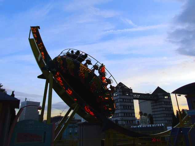 A few brave riders take on the Disko ride at Yokohama's Cosmo World amusement park