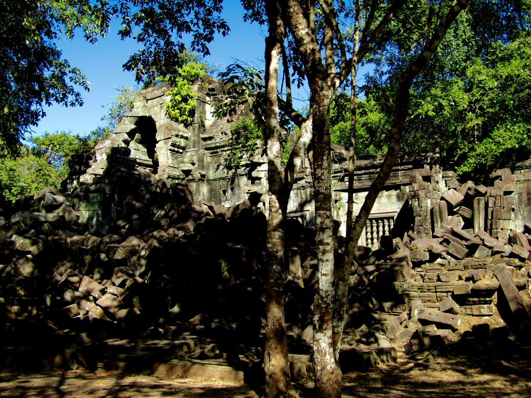 The ruins of Beng Mealea were our favorite of the day. Largely unrestored, the temple has been both held together and taken apart by invasive parasitic trees that weave their roots through the vertical spaces between the stones. While some bricks are pushed apart by the expanding roots, others are wrapped tightly within like twine around a bundle of newspaper.
