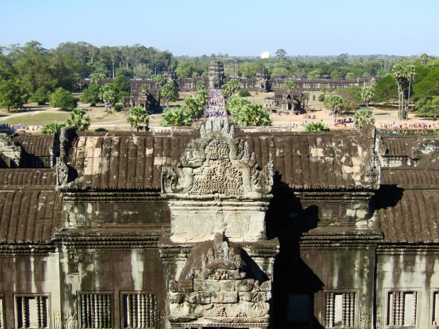 A view of the crowds coming into Angkor Wat via the main walkway. While most Khmer temples face east, Angkor Wat is oriented to the west. A popular theory is that it was meant to serve a funerary function, although the real reason is widely disputed by archeologists.