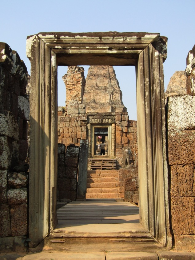 Looking through the sandstone doorway into Eastern Mebon temple. The towers were once covered in white plaster, which would have made them glow in the Cambodian sun.
