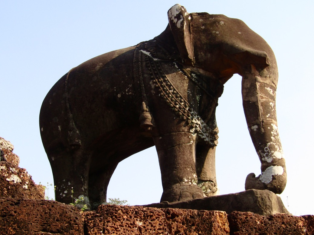 Stone elephant statues sit at each of the four corners of Eastern Mebon temple. The statues are still in excellent condition, rare in Angkor due to plundering by explorers, vandalism by other religious and political sects and various wars.