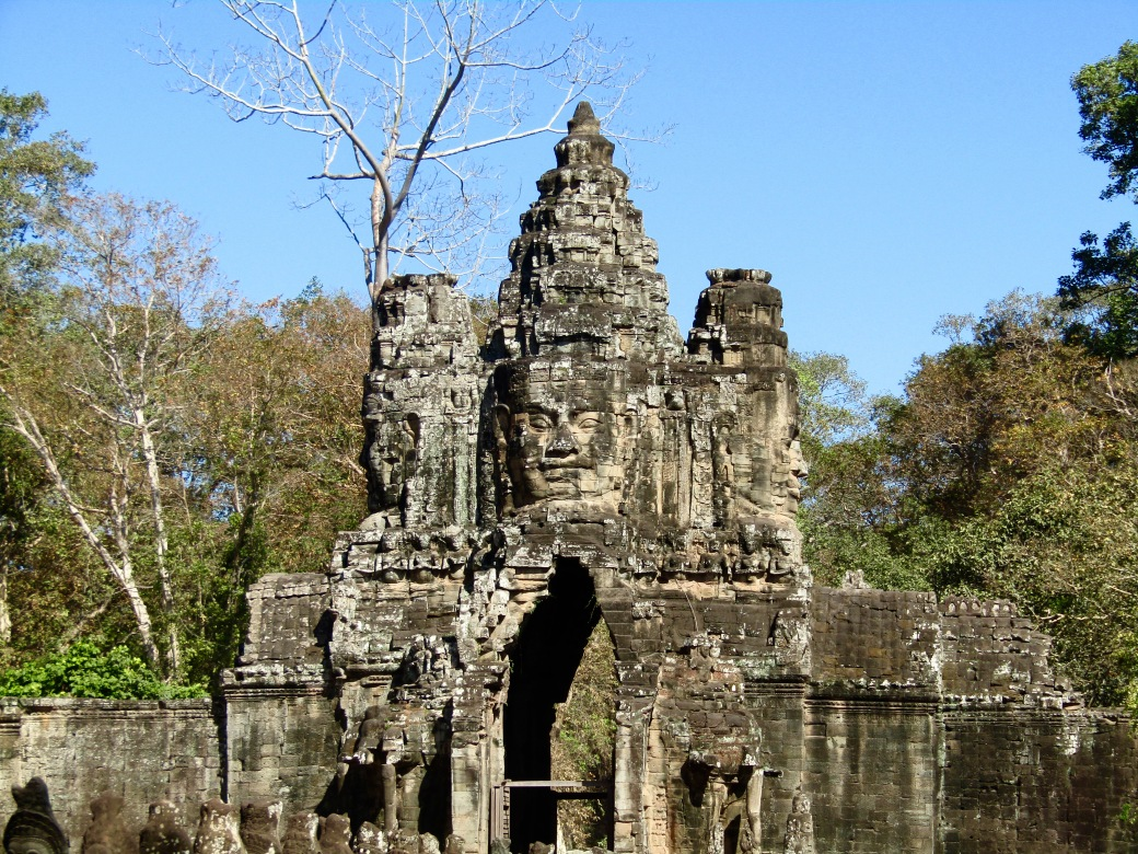 "The southern gate of Angkor Thom features a prominent smiling Buddha face. The last capital of the Khmer Empire, Angkor Thom is perhaps most famous as one of the settings of Angelina Jolie's ""Tomb Raider"" movie."