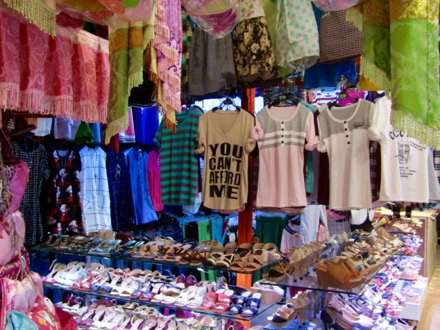 "A t-shirt hanging in one of the booths inside Phsa Leu market says ""You Can't Afford Me."""