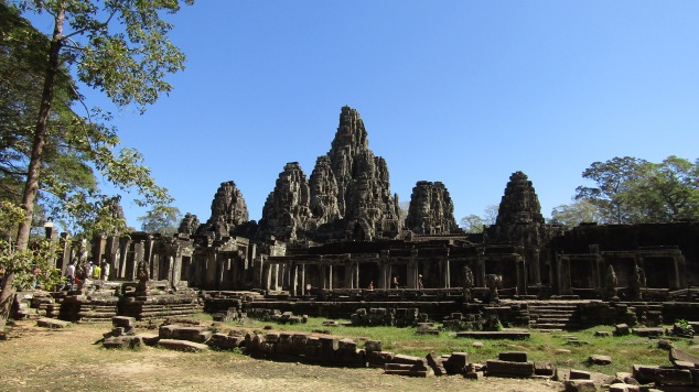 Bayon stands at the exact center of Angkor Thom. More than 200 giant smiling stone faces adorn the temple's 37 remaining towers.