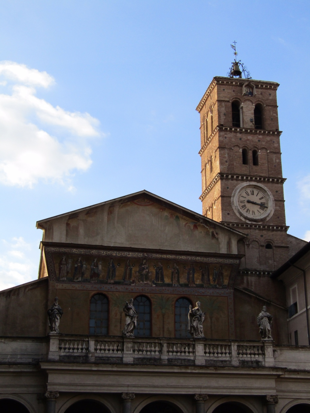 The Basilica of Santa Maria in Trastevere is one of Rome's oldest churches. The public square in front of the church is one of the charming Trastevere districts liveliest community spaces.