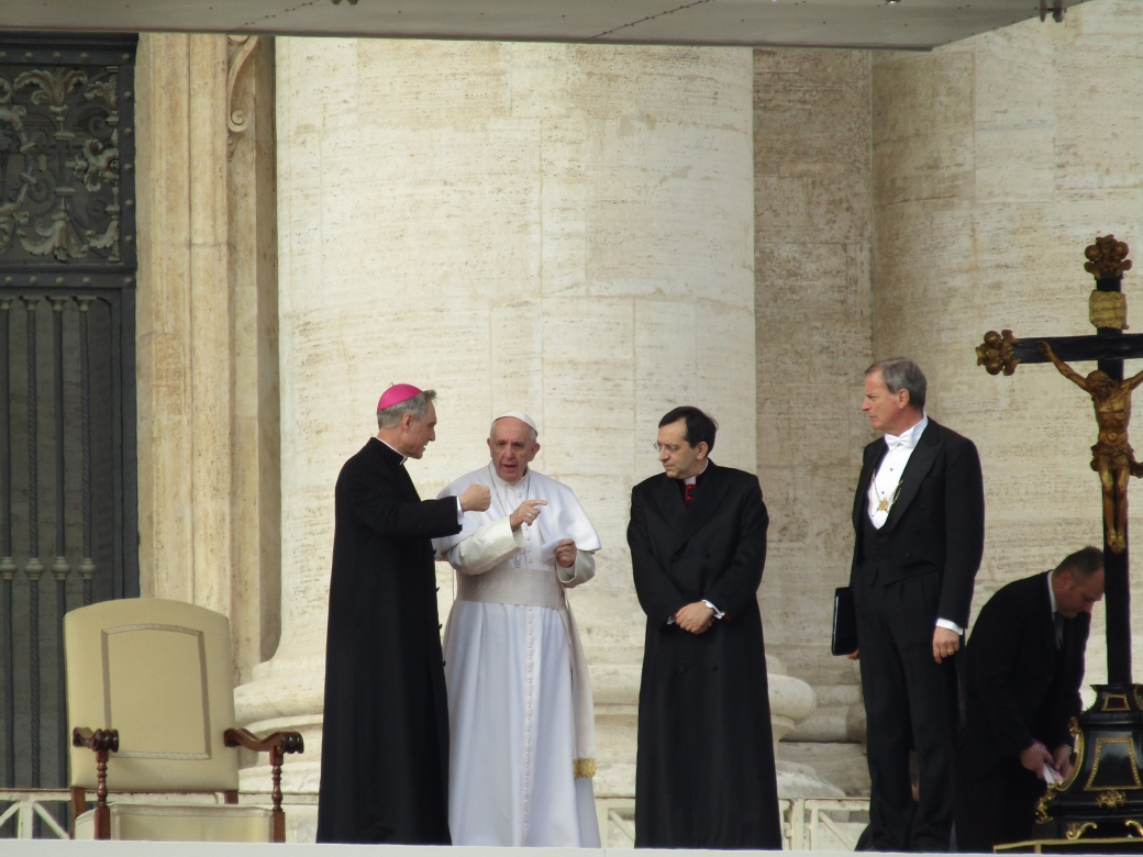 Pope Francis greets the Vatican cardinals following his weekly Wednesday audience with the general public. After the service, the Pope waded into the crowd as they chanted his name.