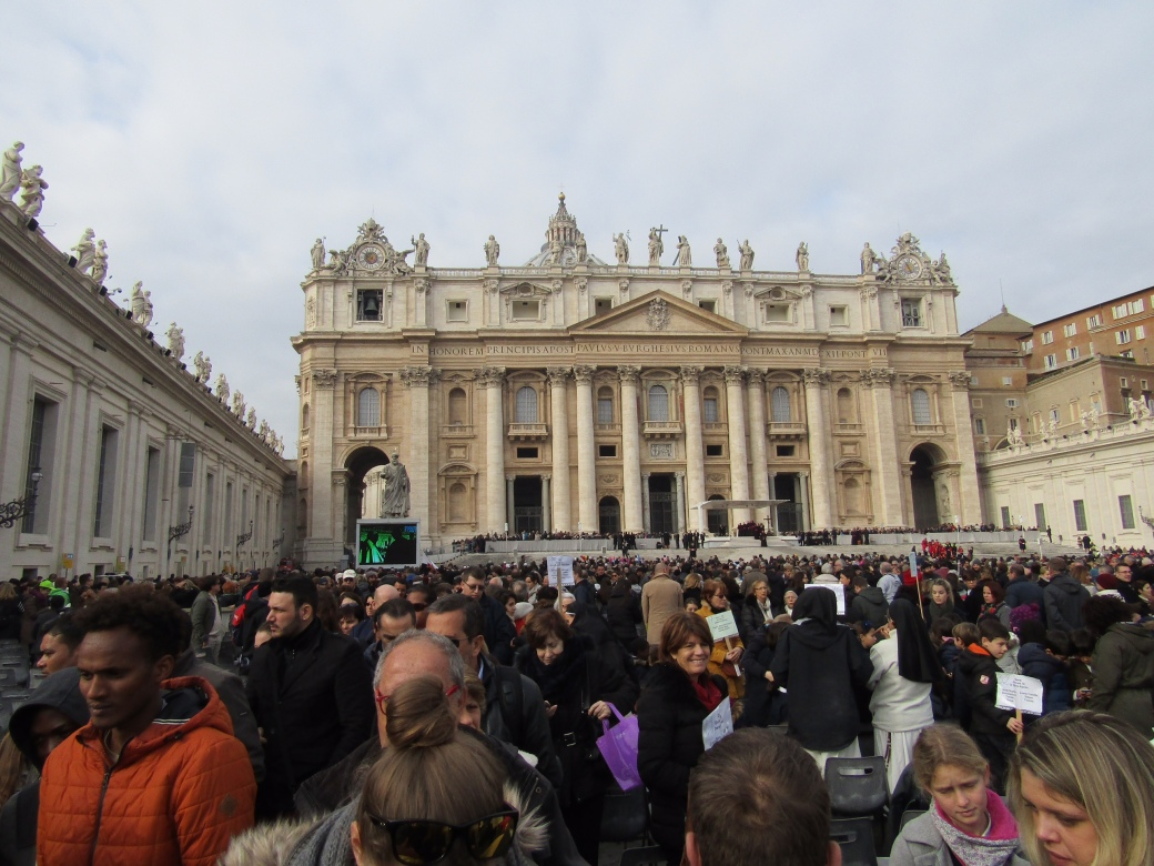 The crowd begins to disperse in front of the Vatican's St. Peter's Square following Pope Francis's weekly audience.