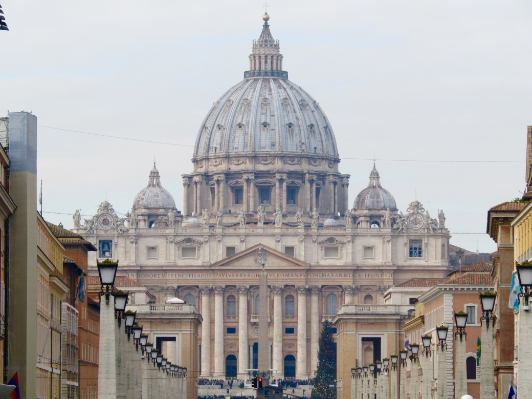 "St. Peter's Basilica as seen from Via Dei Corridori. I love the optical illusion of the street lamps ""bending"" down the street."