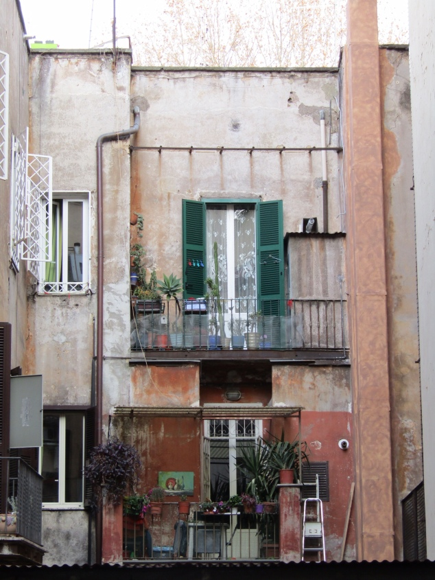 A typical Rome apartment building. The disrepair of the outside is quite beautiful, fitting into the rustic look that dominates this ancient city.