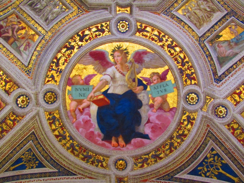 "The Vatican is more than the world headquarters for the Catholic Church. It's also home to a world-class collection of art from some of the great masters including Michelangelo, Leonardo da Vinci, Carvaggio and Raphael. Some of the most prolific work belongs to Rafael, including the four rooms of the Papal apartment known as the Stanze di Raffaello or Rafael Rooms. The rooms are covered in extravagant frescos detailing various tales from Christianity. Ceiling medallions such as this one, entitled ""Poetry,"" depict some of the core tenants of the religion. The phrases held by the angels read ""Touched by the Breath of God."""