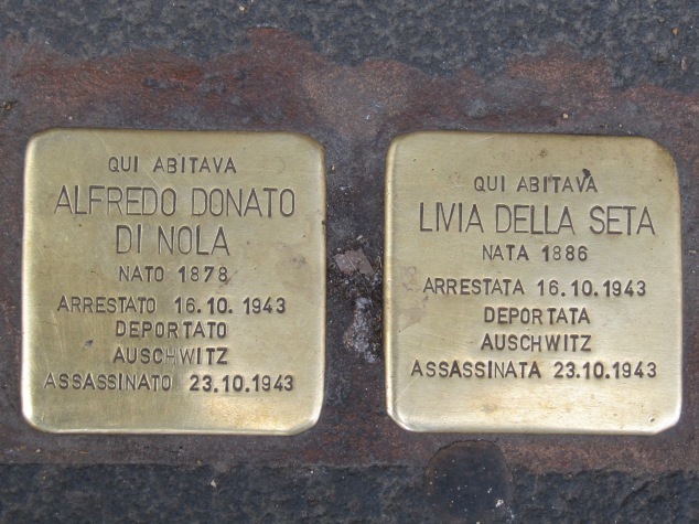 Small brass plates have replaced 100 of the millions of cobblestones in the streets of Rome. They're part of a project by German artist Gunter Demnig to commemorate victims of the Holocaust. These two plaques were in front of the home where Alfredo Di Nola and Livia Seta lived when they were taken to the Auschwitz concentration camp. Demnig has set more than 48,000 plaques in 18 European countries, making it the world's largest memorial.