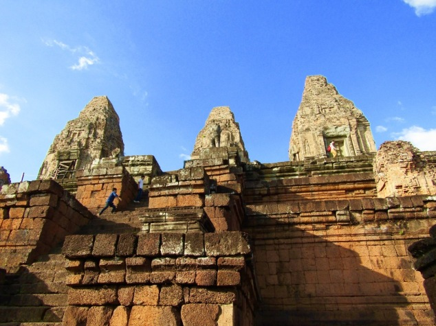 Tourists climb the steep steps at Pre Rup, largely intact thanks to some advanced construction techniques. The temple was built in the early 10th century during the reign of King Rajendravarman as a funerary for local people. The burning pit and a basin for washing the ashes can still be found on the grounds.