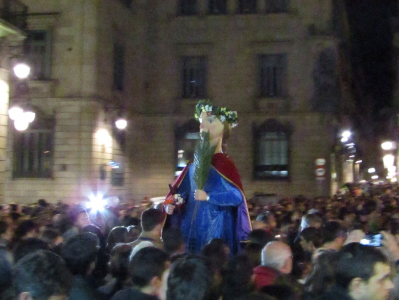 Saint Eulalia, or Laie, wades through the crowds at the end of the procession through the narrow city streets.