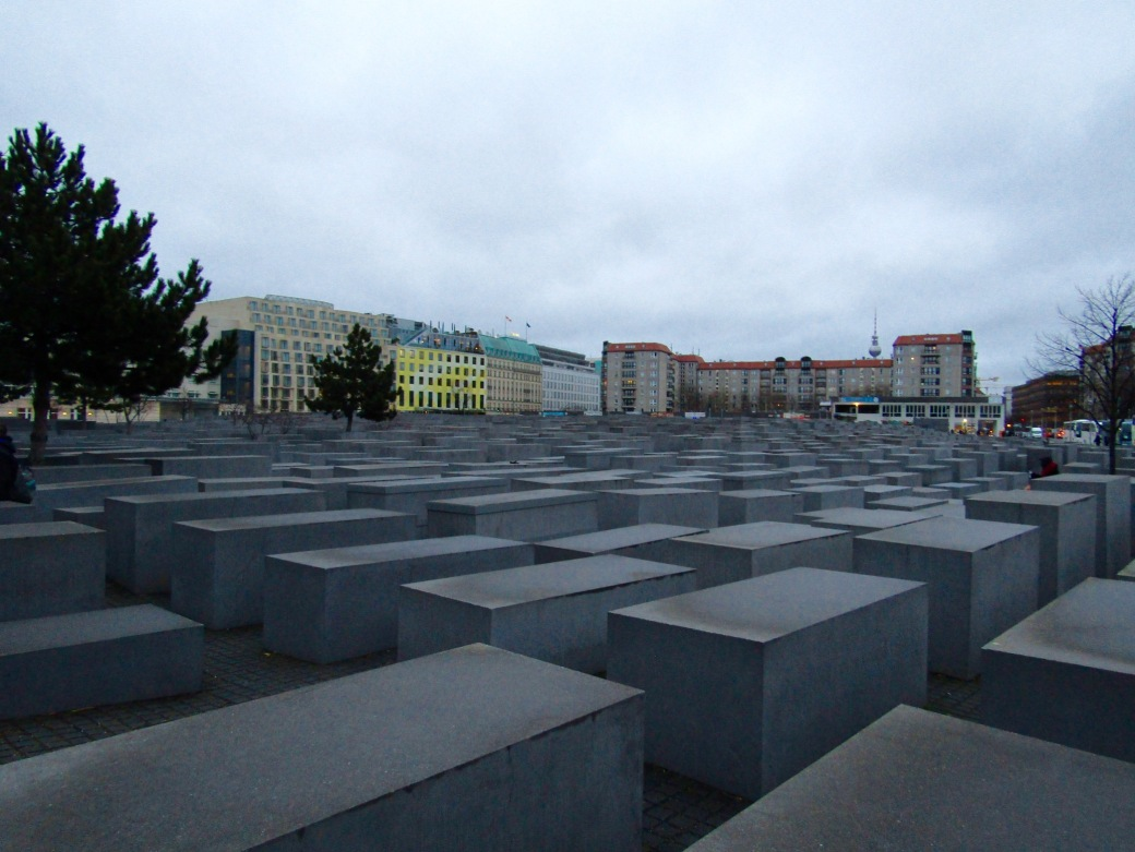 "The Memorial to the Murdered Jews of Europe is a far-reaching series of stone slabs with varying heights. According to documents, the memorial is ""designed to produce an uneasy, confusing atmosphere, and the whole sculpture aims to represent a supposedly ordered system that has lost touch with human reason."""