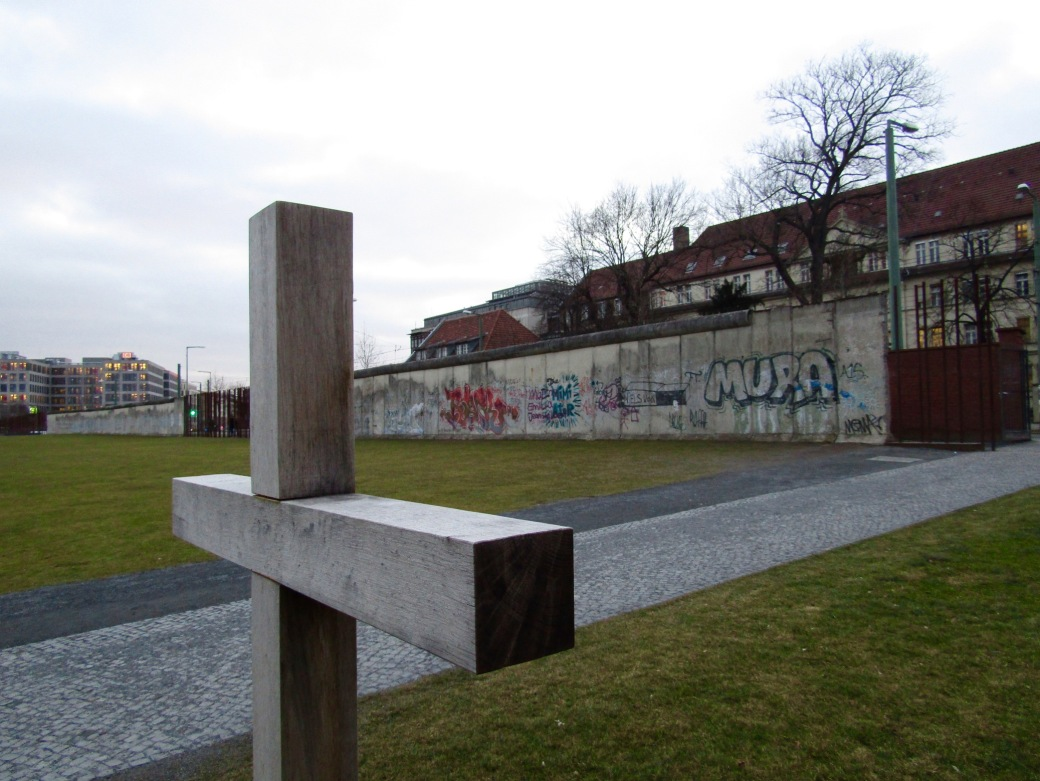 A cross placed by the Church of Reconciliation at the memorial. The church's membership was divided by the wall. In 1985, the church was destroyed by the East German government.