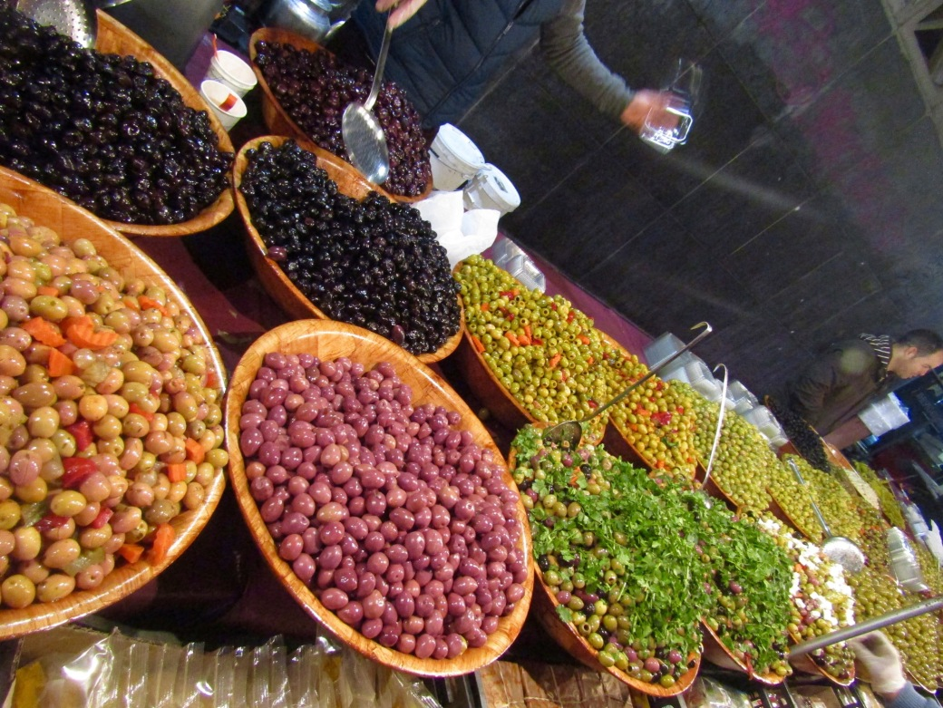An olive vendor's bounty at Marché de la Gare du Midi.