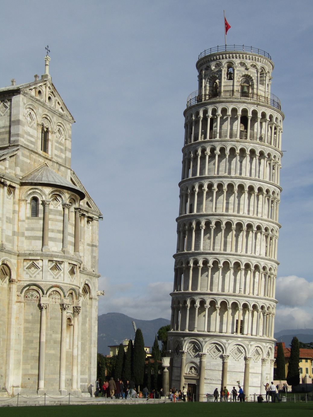The neighboring Baptistry provides a point of comparison to show the amount of lean in the tower.
