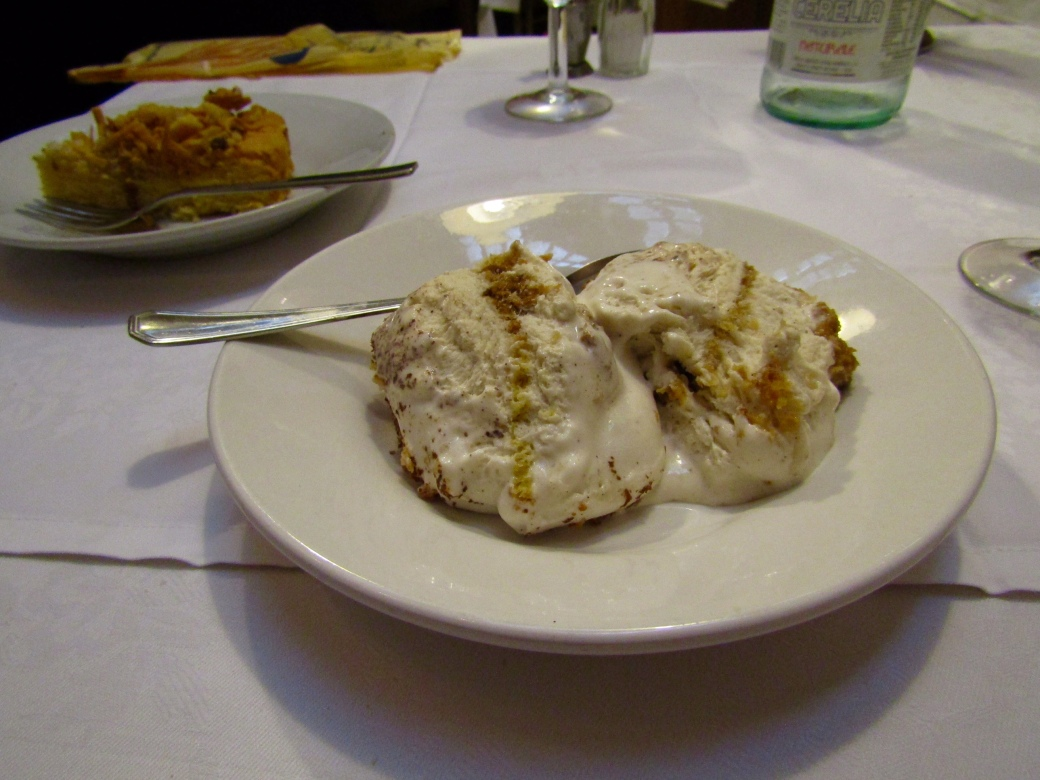 Dessert of almond cake and semifreddo al mascarpone, better known as tiramisu.