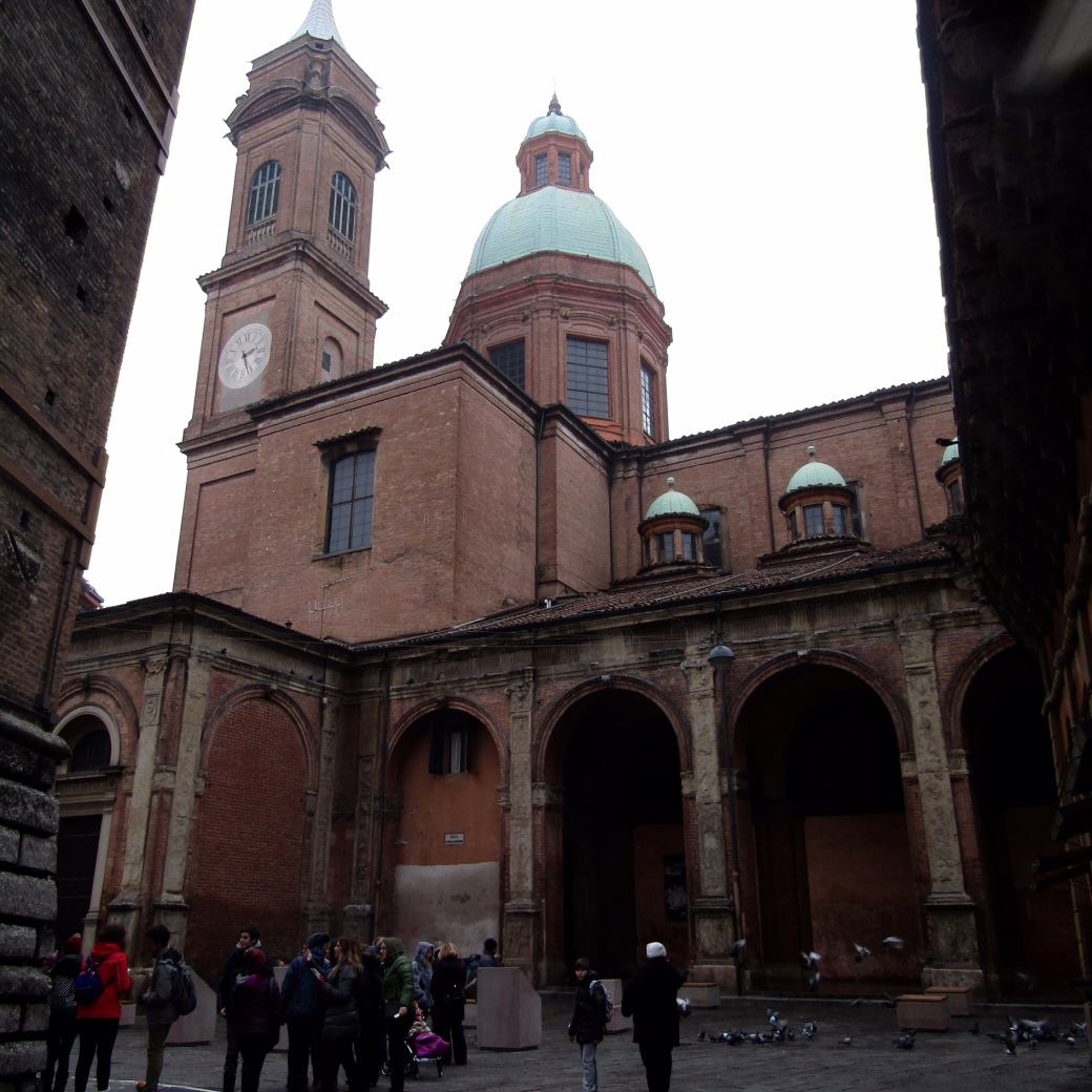The basilica and clock tower of Santi Bartolomeo e Gaetano near Bologna's iconic Due Torri (Two Towers).