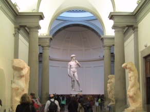 View of the statue upon entering the gallery. Some of Michelangelo's unfinished works can be seen along the sides.