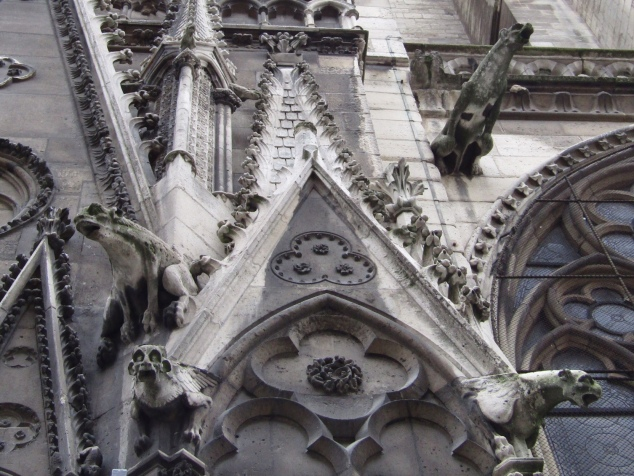 Chimera statues on Notre-Dame's north wall. The statues are part of the gothic-style decor while also serving a functional purpose as rain spouts.