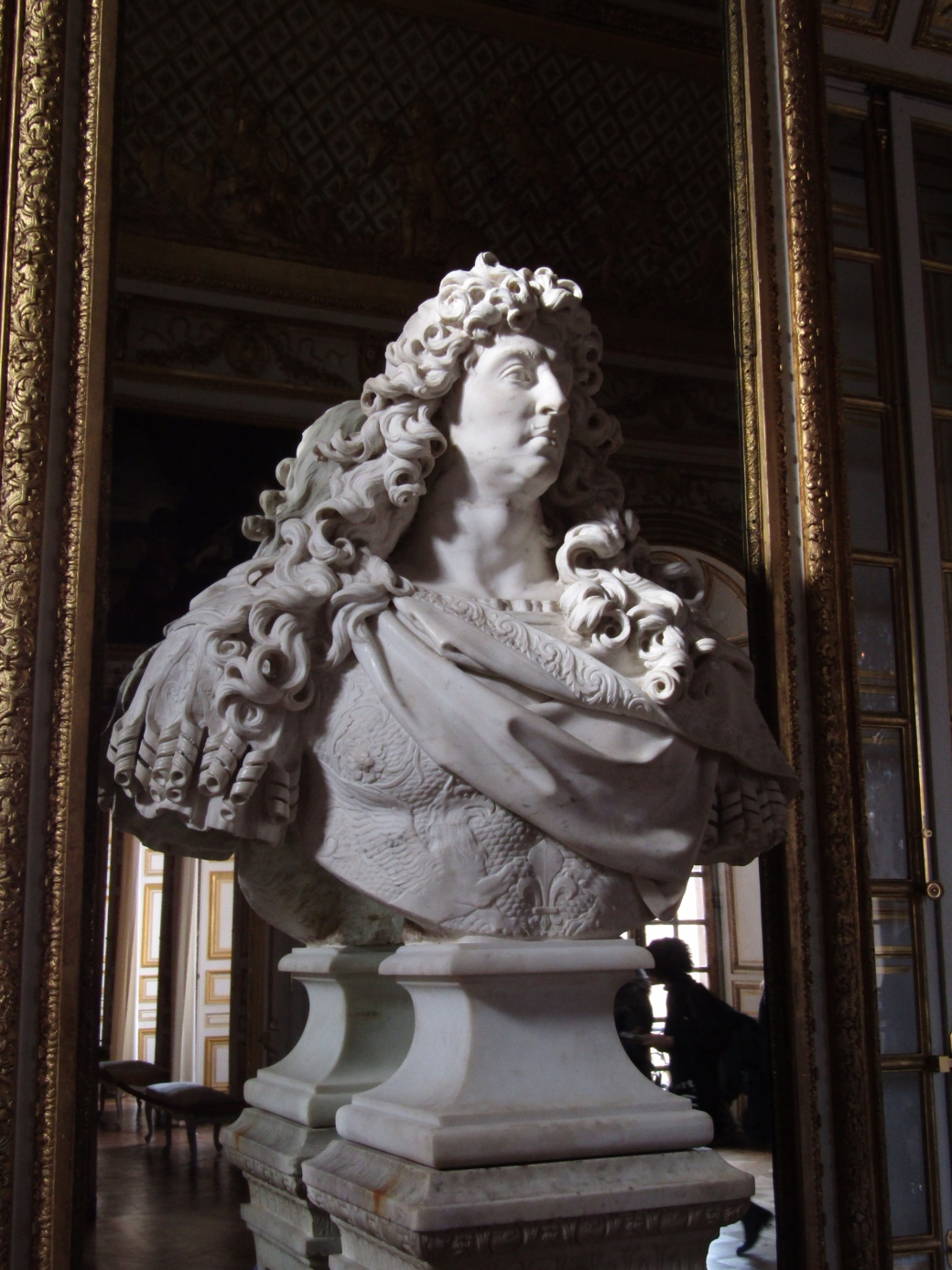 A bust of Louis XIV sits in the Bull's Eye Salon of the King's Chamber.
