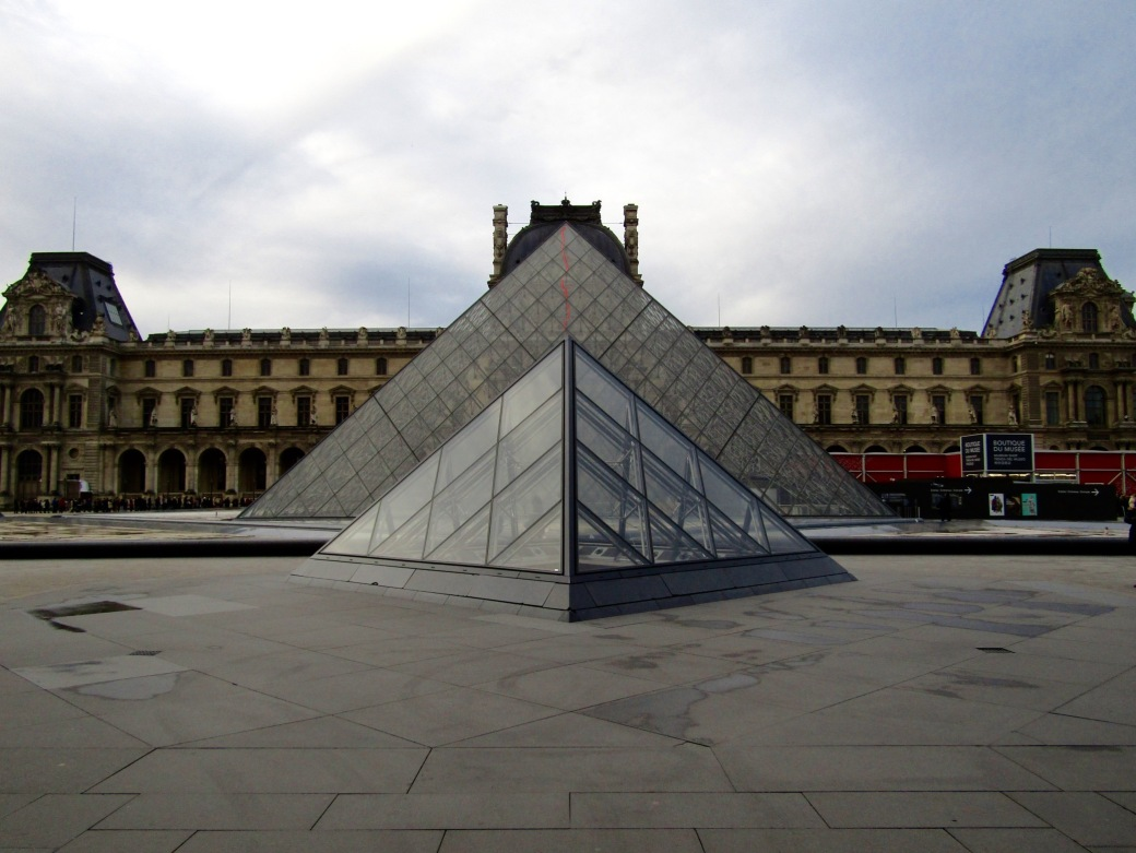 The glass pyramids outside of the Louvre were designed by I.M. Pei as a way to move the museum's entrance underground and alleviate the masses of people flowing through the old, small entrances. They are now works of art in their own right.