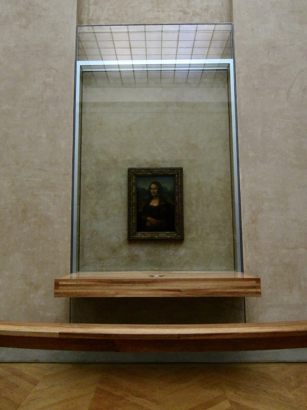 The Mona Lisa has been behind bulletproof glass for several decades due to multiple attempts at vandalism. The painting has been at the Louvre since the end of the French Revolution but for a brief time spent hanging in Napoleon's bedroom.