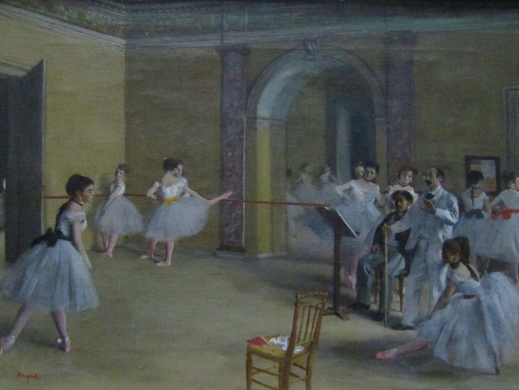 Edgar Degas was both a talented painter and sculptor. Degas's three-foot tall bronze sculpture of a young ballerina stands near this painting of young dancers. More than half of his works featured dancers.