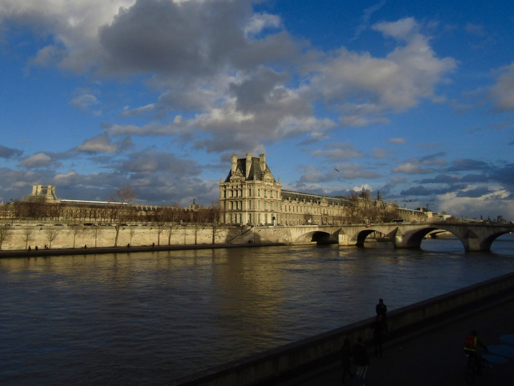 Looking back at the Louvre from the left bank of the Seine. The museum was originally a fortress and the center of French politics until Louis XIV moved the government to Versailles.
