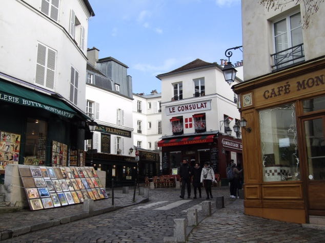 "The shops of Place du Tertre. Folklore says the word ""bistro"" was coined here by Russian soldiers ordering food at the cafe who would shout ""bystro,"" the Russian word for ""quickly."""