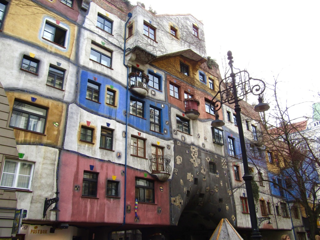 Hundertwasserhaus, a crooked, nature-filled apartment complex based on the eccentric architectural ideas of Friedensreich Hundertwasser.