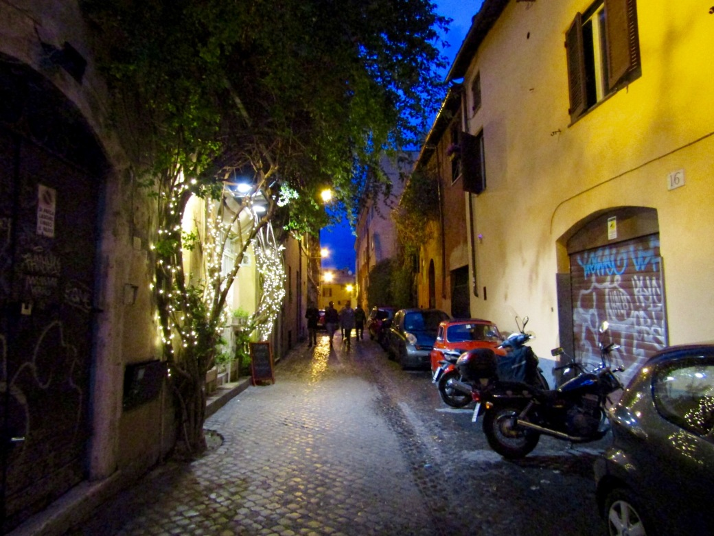 The charming streets of Trastevere at night.