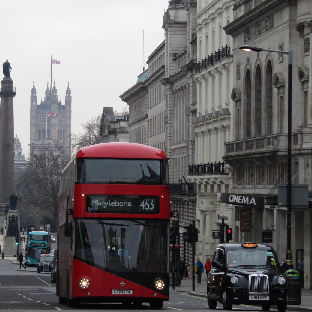 London's signature double-decker bus and hackney carriage (taxi) compete for space near Piccadilly Circus.