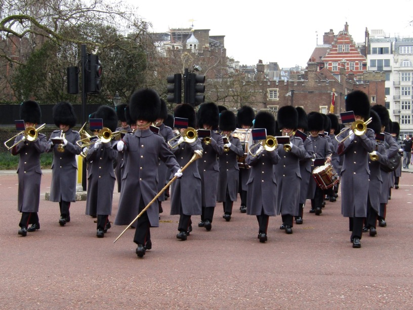 The Household Troops band and New Guard relief corps march down Marlborough Street toward Buckingham Palace.