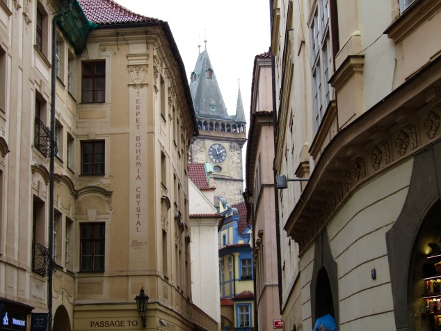 The Old Town Hall peeks through a narrow alley in Old Town.