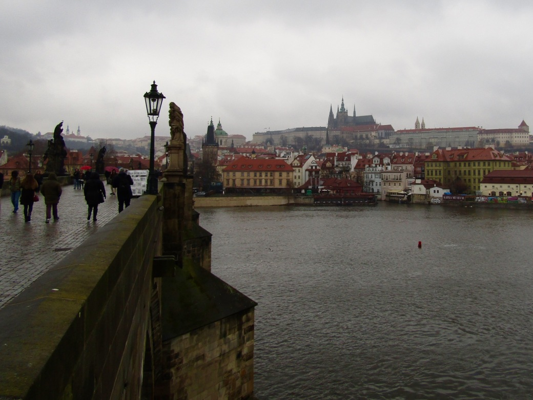Crossing the Vltava River via the Charles Bridge.