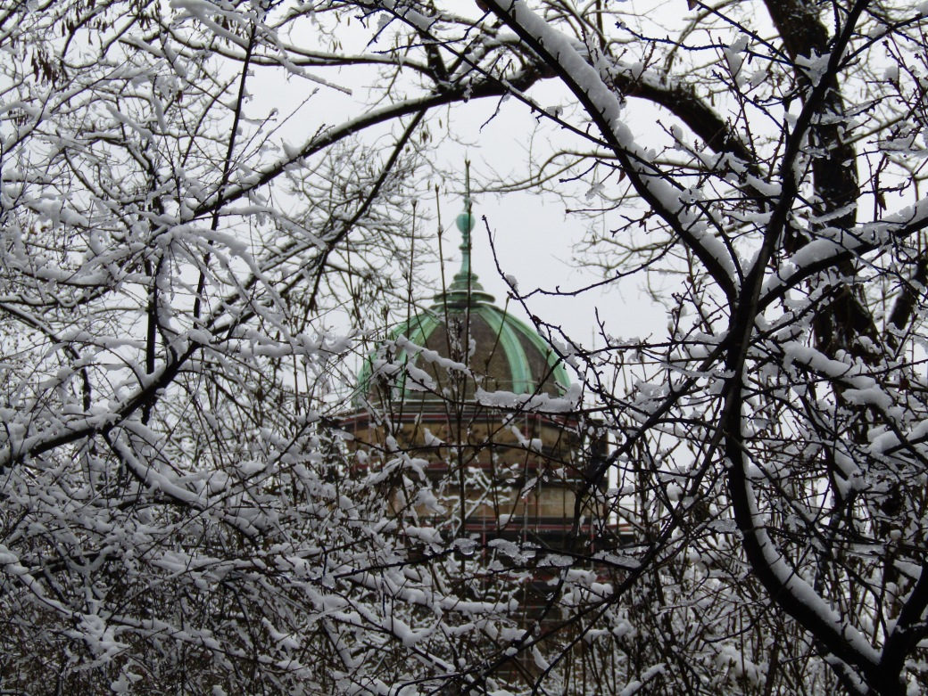 The dome of the Prague National Museum from snow-covered Čelakovského Sady.