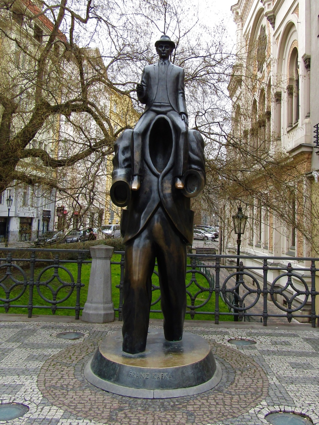 Prague's official Franz Kafka monument shows the author sitting on the shoulders of a headless man, inspired by his short story Description of a Struggle.