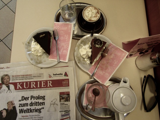 Partaking in Vienna's favorite pastime, hanging out in a cafe with some cake, coffee and a newspaper.