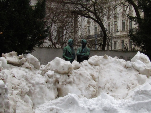 This statue of two men on the Rathaus grounds caught my eye as they appeared to be discussing what to do with the giant pile of snow in front of them.