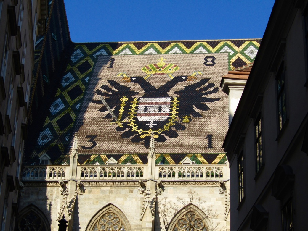The double-eagle emblem on the roof of St. Stephen's Cathedral. The emblem is the coat of arms for the House of Lorraine, one of Europe's longest-ruling royal families.