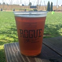 The Rogue Farms 8-Hop IPA at the farm in Independence, Ore. Rows of Rogue's proprietary hops can be seen growing in the background.