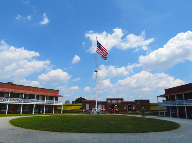 The garrison flag flies in the courtyard of Fort McHenry. The flag has 15 stars and 15 stripes, representing each of the colonies at the time. It was the only version of the flag with more than 13 stripes.