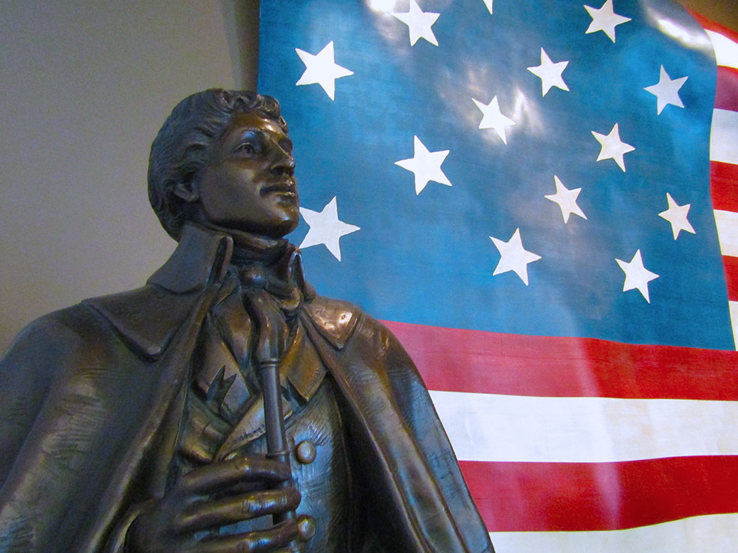 A statue of Francis Scott Key, author of the Star-Spangled Banner, greets visitors to Fort McHenry.
