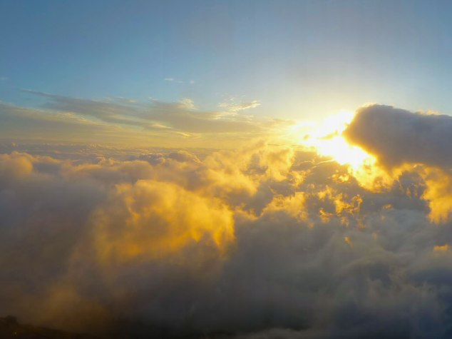 The view of the sunrise from the summit of Mount Fuji makes climbing through the night all worth it.